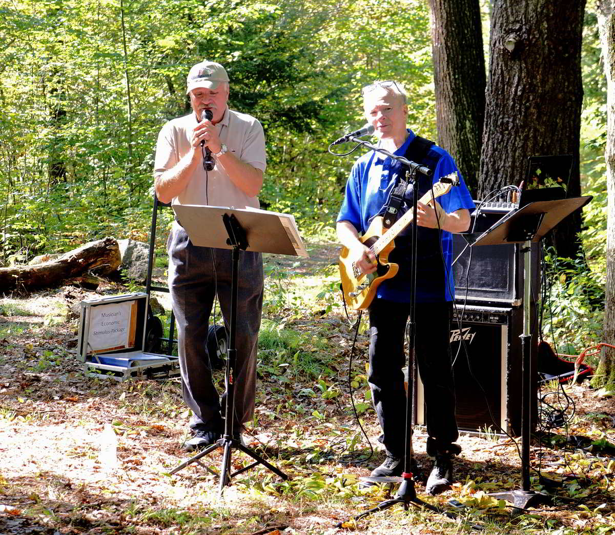 2-person band playing at springdale mill celebration