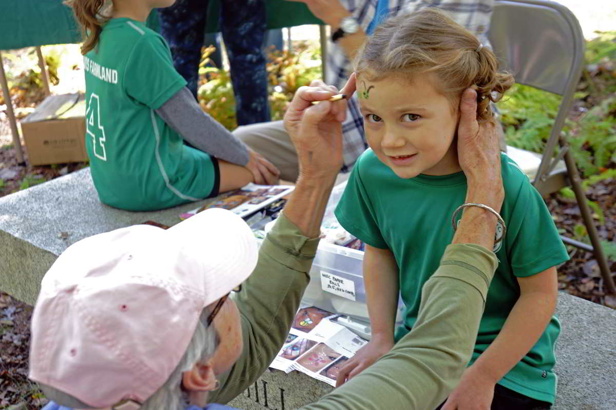 girl getting her face painted at springdale mill celebration