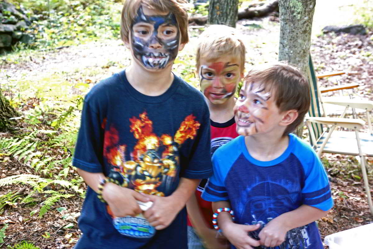 three boys with faces painted